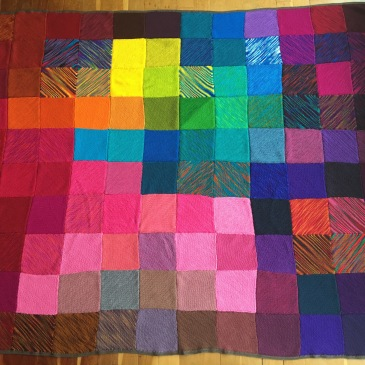 22 knitters from 8 countries and 3 continents send knitted love to a grieving friend in this knitted patchwork blanket