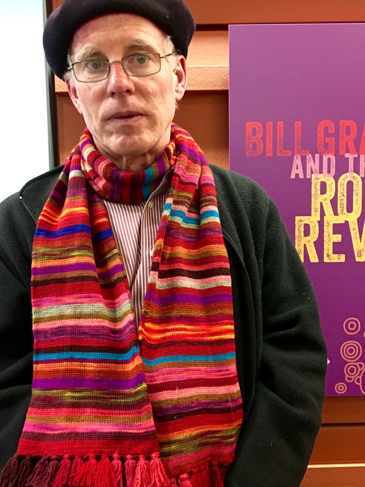 Machine knit scarf modeled by its owner