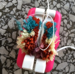 Pompom, cut open and tied securely