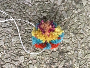 One side of multicolored pompom