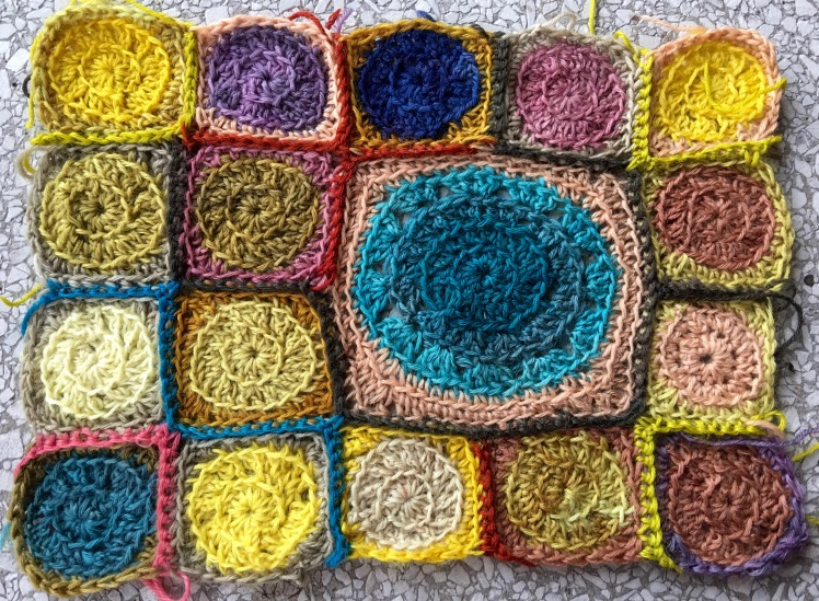 Crocheted motifs combining plant-dyed colors with acid-dyed colors