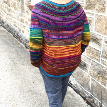 Back view of pullover in Wollmeise multis