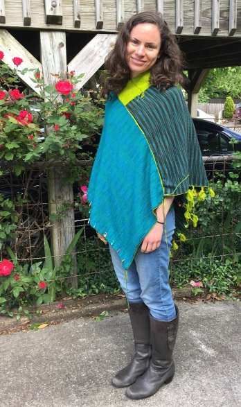 alternate face of unfinished machine knit poncho front view