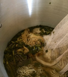 Yarn of various fibers in nettle dye bath