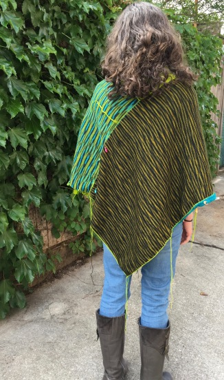 rear view of one face of unfinished machine knit poncho