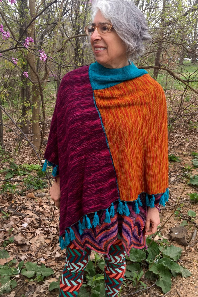 One of four faces of reversible machine-knit poncho