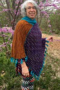 reverse face of double-sided machine-knit poncho