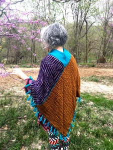 reverse face of double-sided machine-knit poncho, rear view