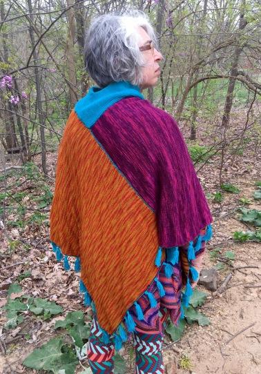 Back view of one of four faces of reversible machine-knit poncho