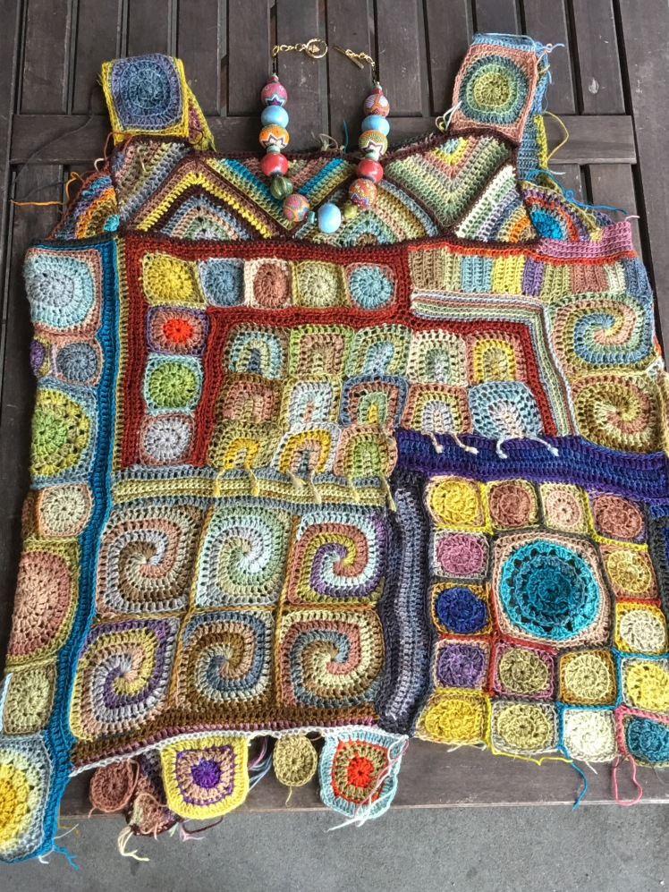 Assembly of crocheted patchwork top completed