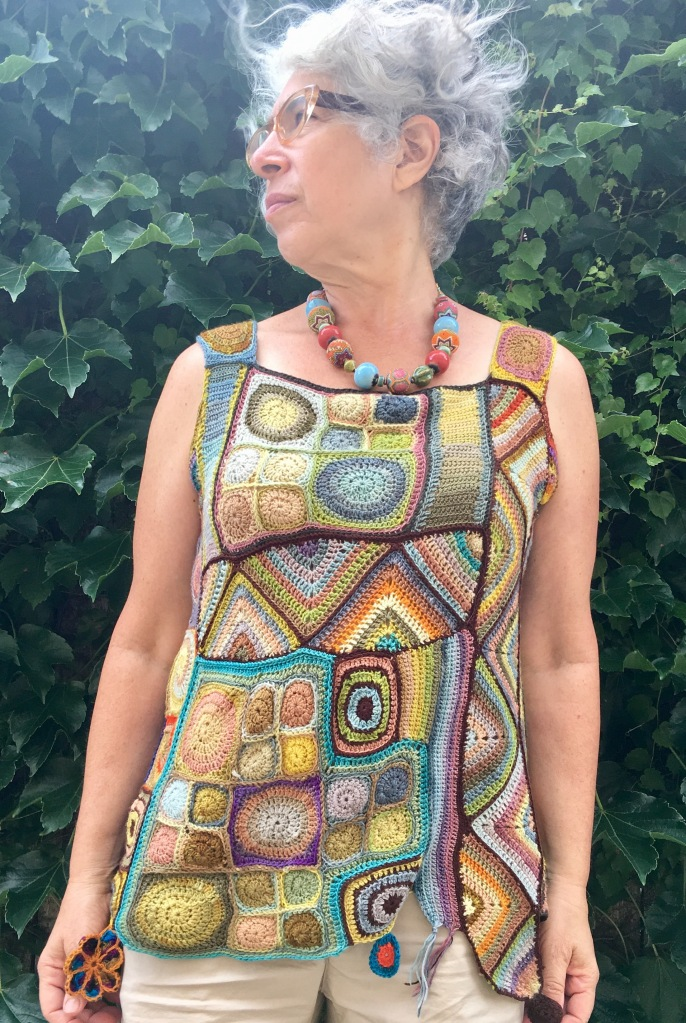 crocheted patchwork top made of plant-dyed yarn