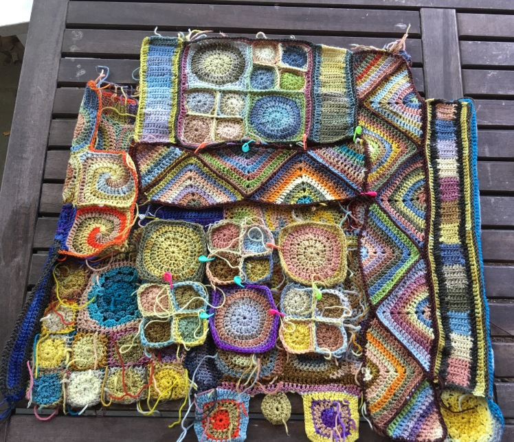 Assembly of crocheted patchwork top nears completion