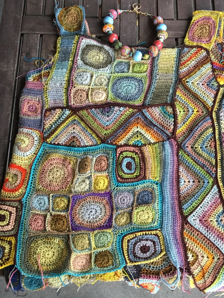 Assembly of second side of crocheted patchwork top is completed