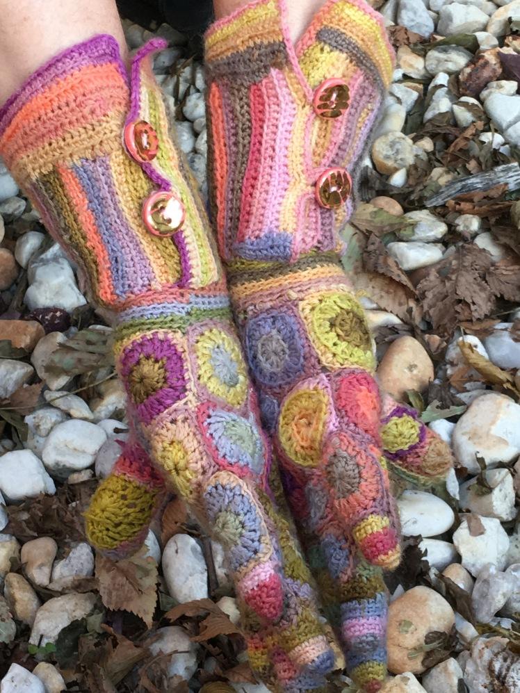 Sideways view of patchwork crochet gloves