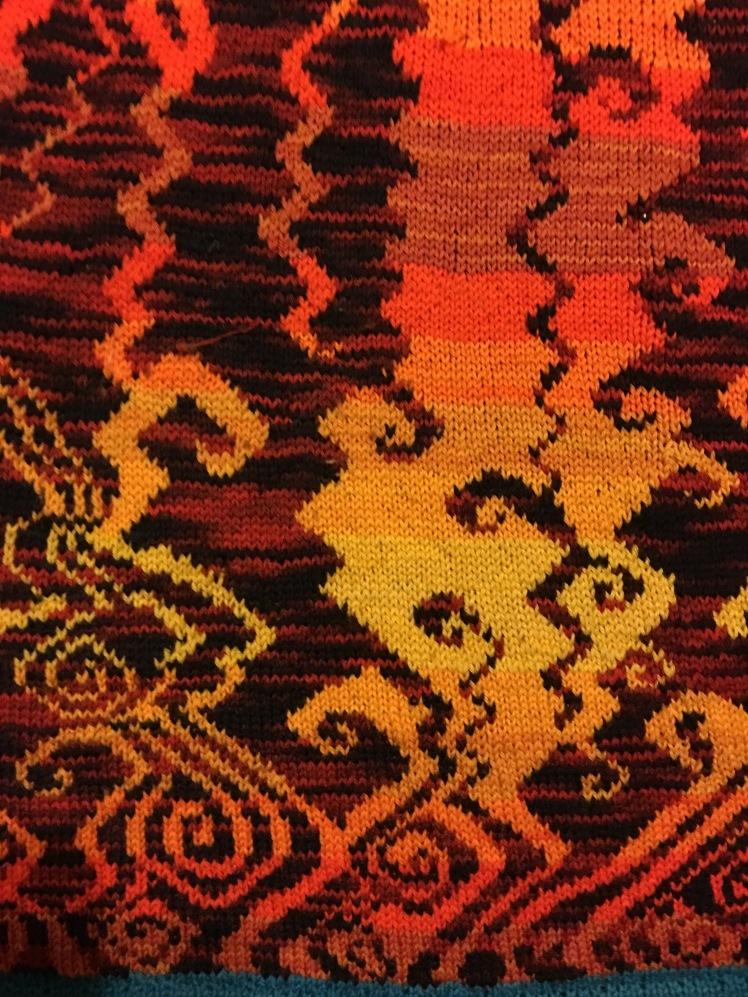 Improvised stranded knitting evoking a hellscape