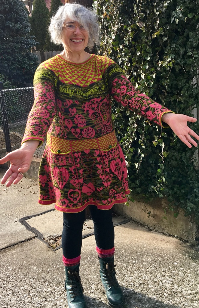 Front view of knitted dress with symbolic social commentary