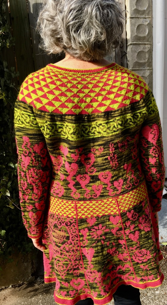 Rear view of knitted dress with symbolic social commentary