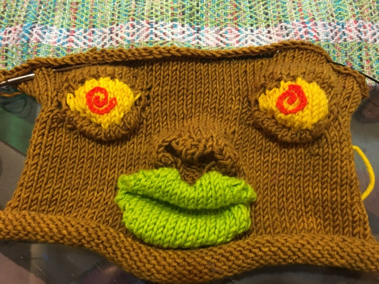 Knitted face designed by Katarina Brieditis