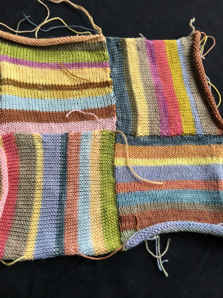 Swatch of machine-knit squares attached modularly in a patchwork