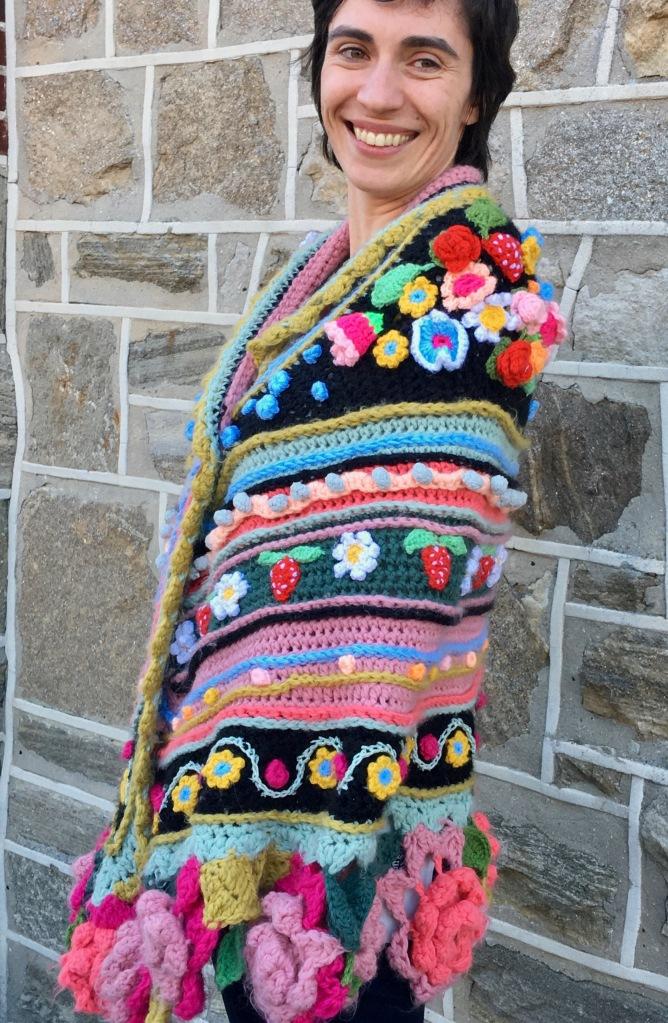 Modeled crochet shawl showing embellishments on left shoulder