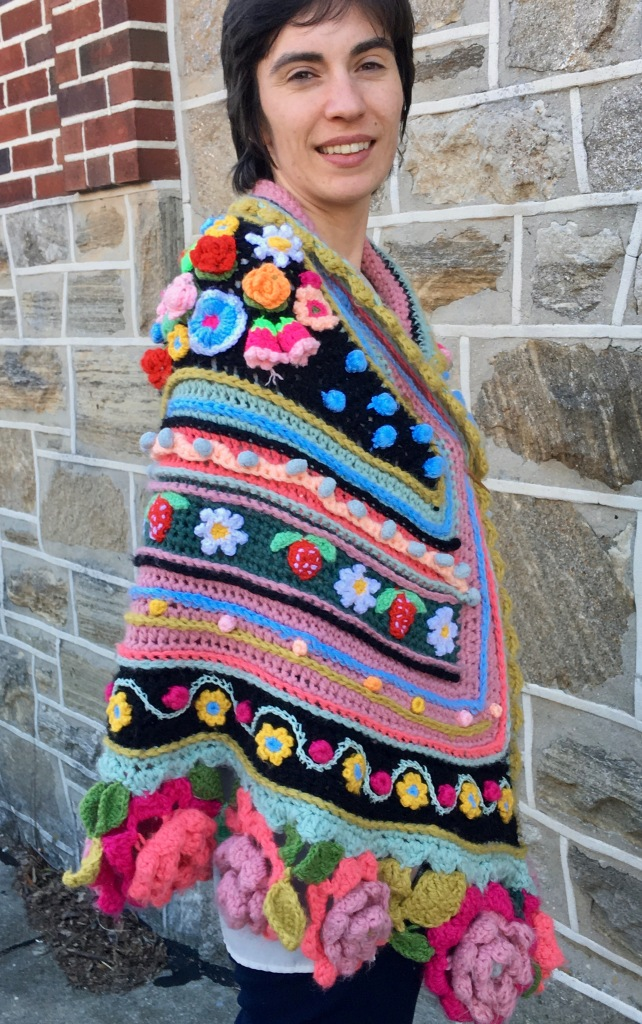 Modeled crocheted shawl showing embellishments on right shoulder