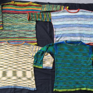 Four machine-knit pullovers