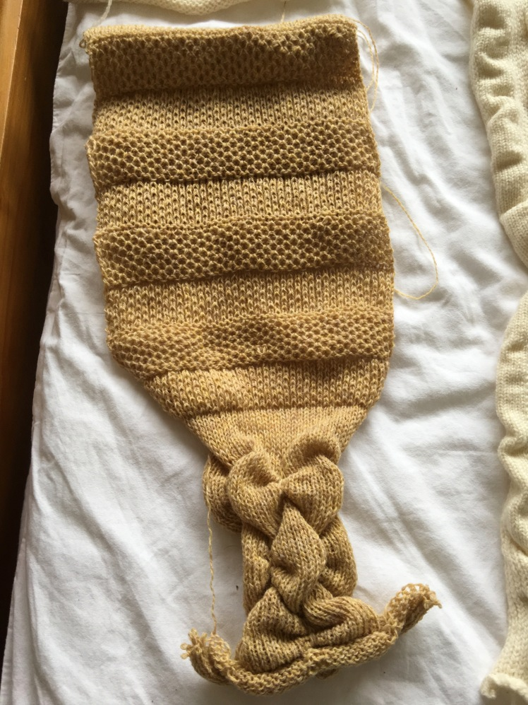 machine-knit sampler of tuck stitches and use of garter bar