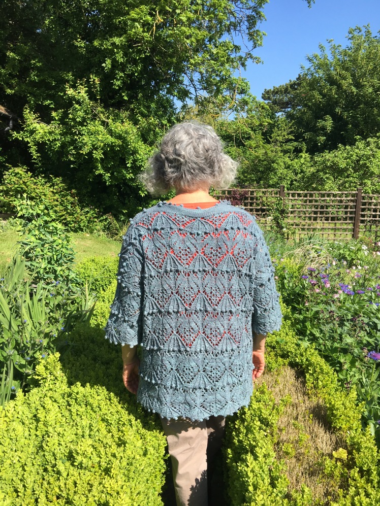 Modeled rear view of pullover with Japanese stitch pattern