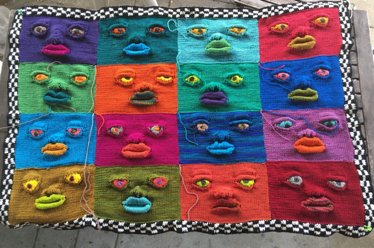 16 faces joined and bordered in checkerboard double-knitting