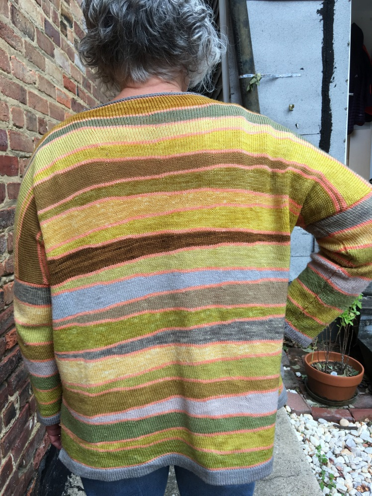 Back view of plant-dyed pullover machine-knitted in short-row wedges