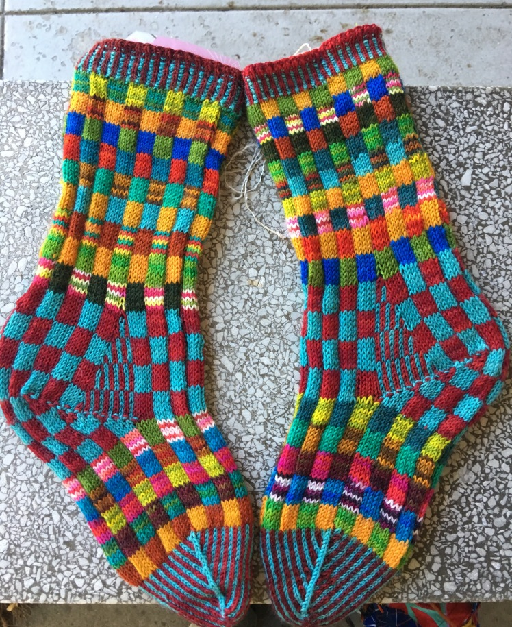 Colorful knitted socks in checkerboard pattern