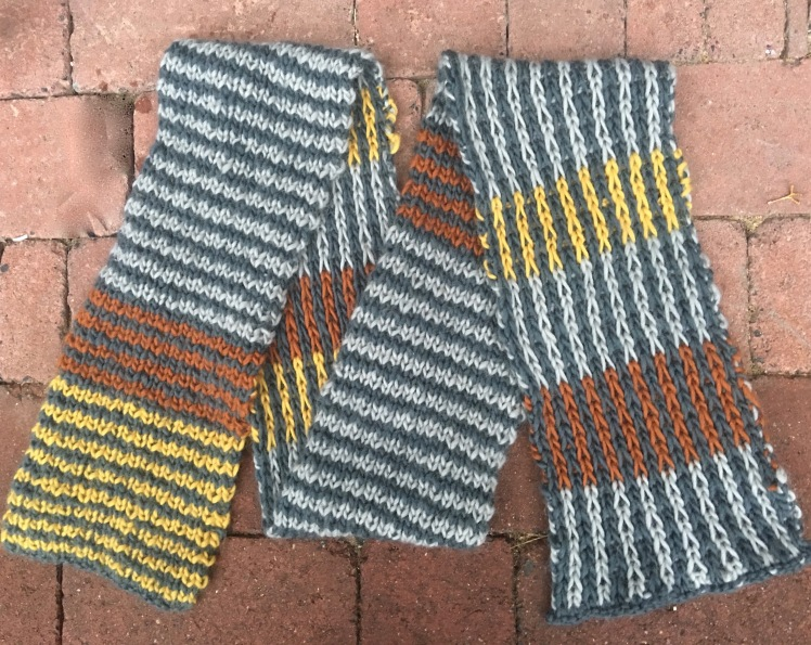 Two-sided knitted scarf, horizontal striping on one side, vertical on the other
