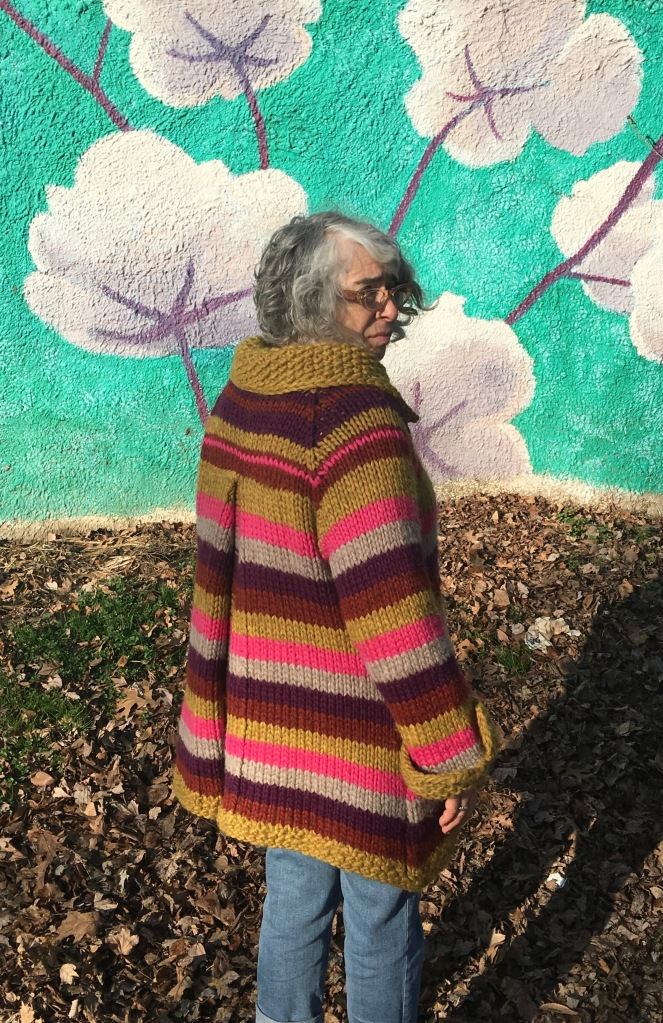 Over-the-shoulder view of knitted coat