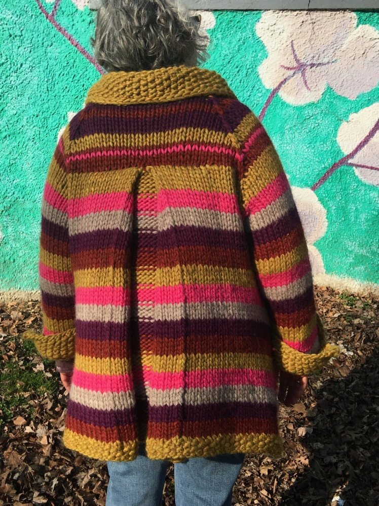 Back view of box pleat in modeled knitted coat