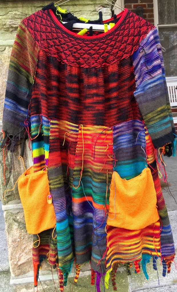 Inside-out view of machine-knit dress at finishing phase