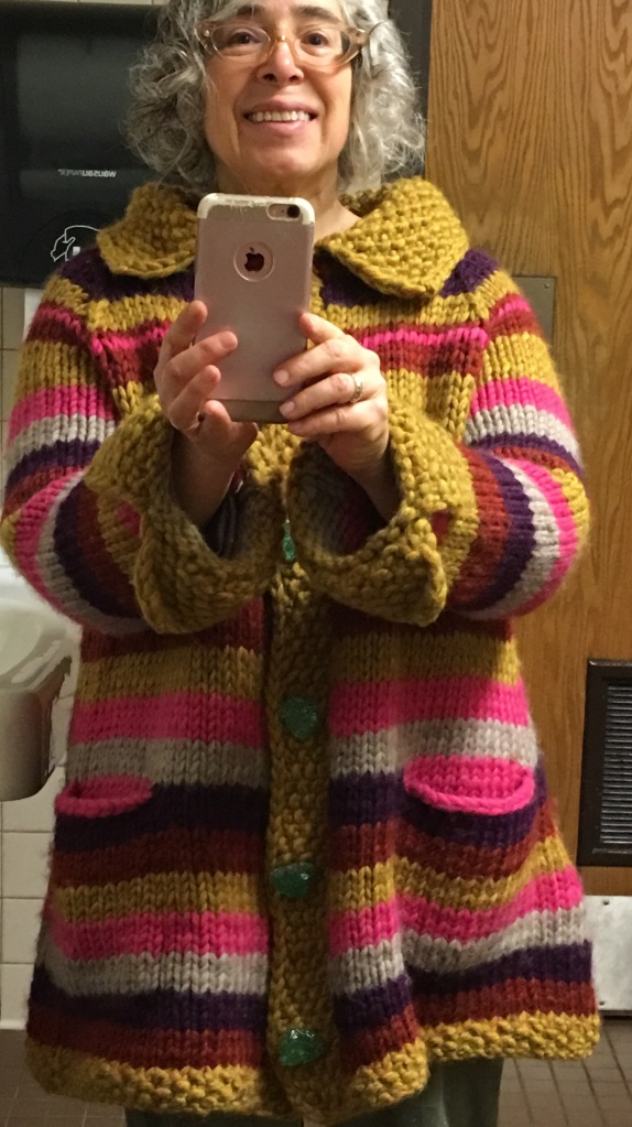 Knitted coat, modeled