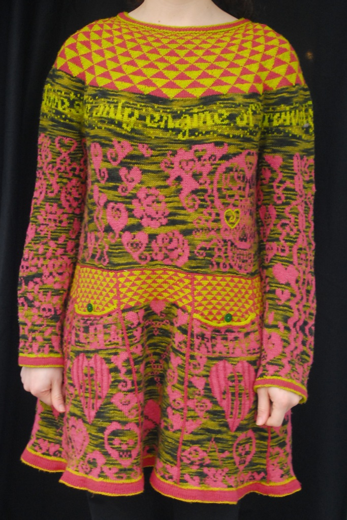 Improvised stranding dress patterned with symbolism