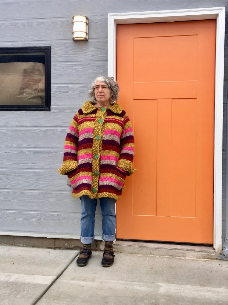 Striped knitted coat with pockets