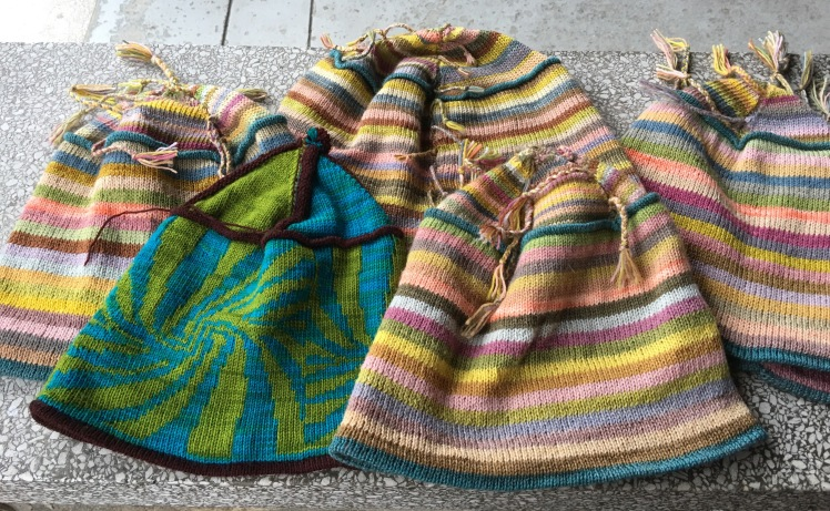 Machine-knit hats in plant-dyed yarn and preprogrammed fairisle patterning