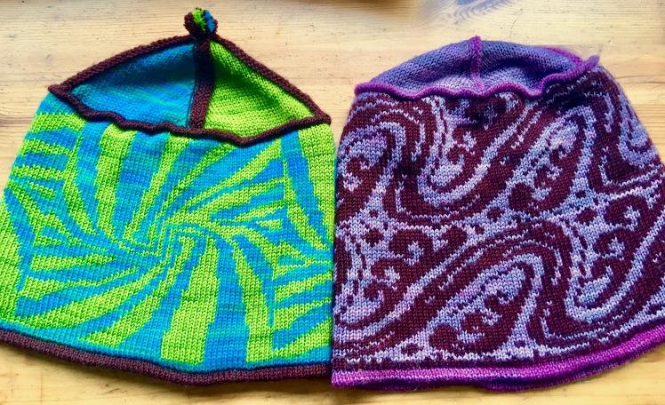 Machine-knit hats knit in Stitch World preprogrammed fairisle patterns