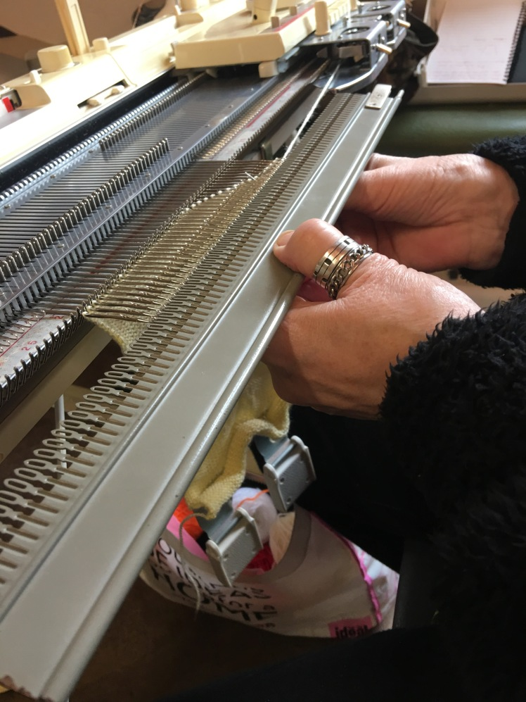 Transferring machine knitting from needles to garter bar