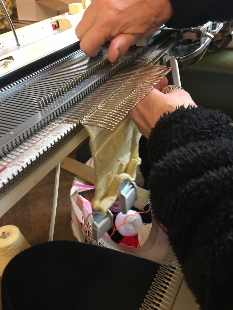Knitting machine needles in hold position