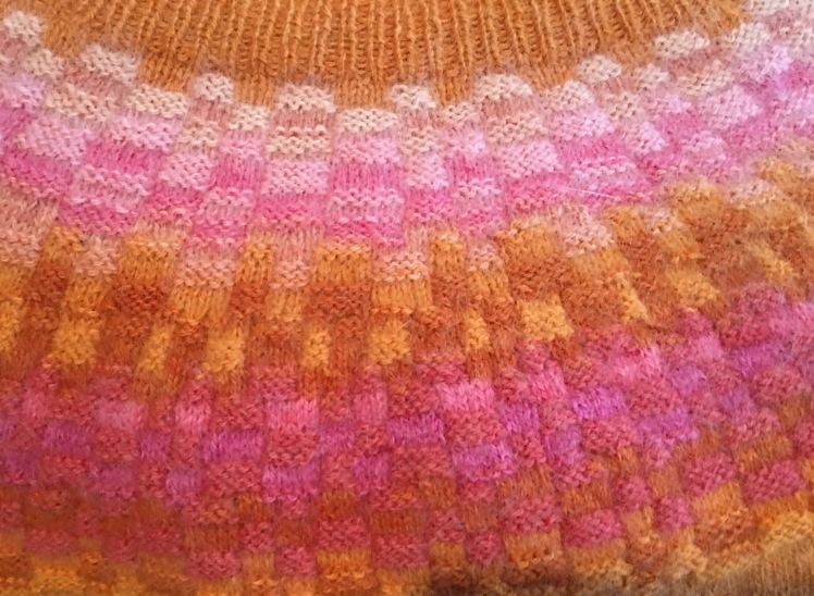 Bohus knitting in orange and pink